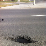 Potholes at 7670–7798 Falconridge Blvd NE