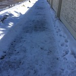 Snow on Park Pathway at 15 SUNLAKE CL SE