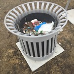 Garbage in a park at 5007 BOWNESS RD NW