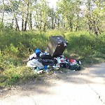 Garbage in a park at 1635 DEERFOOT TR SE