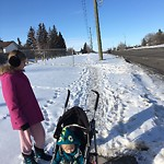 Snow on Pathway or City-maintained Sidewalk at 909 68 ST NE