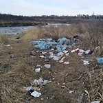 Garbage in a park at 8306 DEERFOOT TR SE