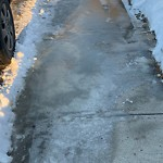 Snow on Pathway or City-maintained Sidewalk at 2032 Pinetree Cr NE
